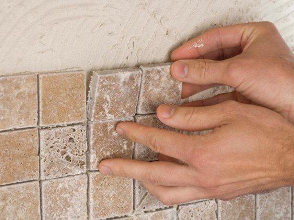 Installing a tile a tile backsplash