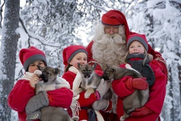 Santa and Elves in Rovaniemi by Visit Rovaniemi
