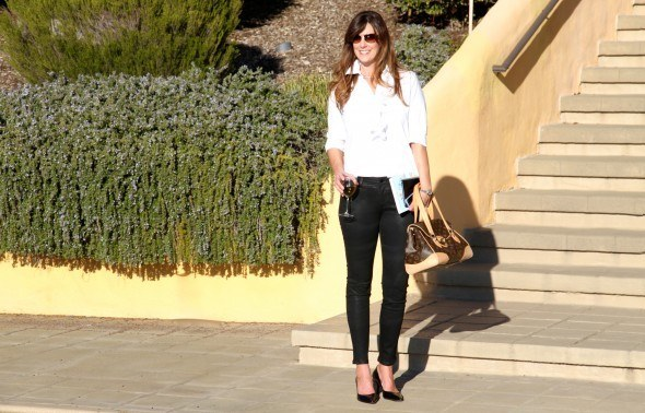 Ruffled blouse, coated skinny jeans, Louis Vuitton bag at a private villa