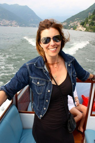 Denim jacket and black ruched dress on Lake Como
