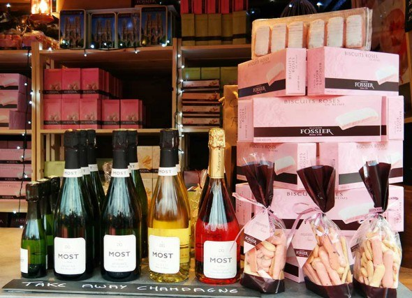 Take away champagne at the Champs-Elysées Christmas market in Paris.