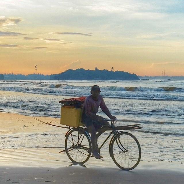 sri lanka beruwala beach fisherman going to work
