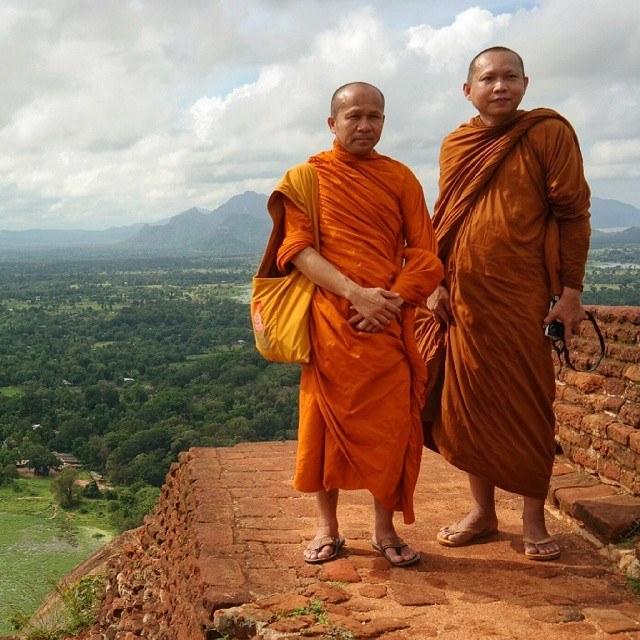 sri lanka monks at sigiriya rock