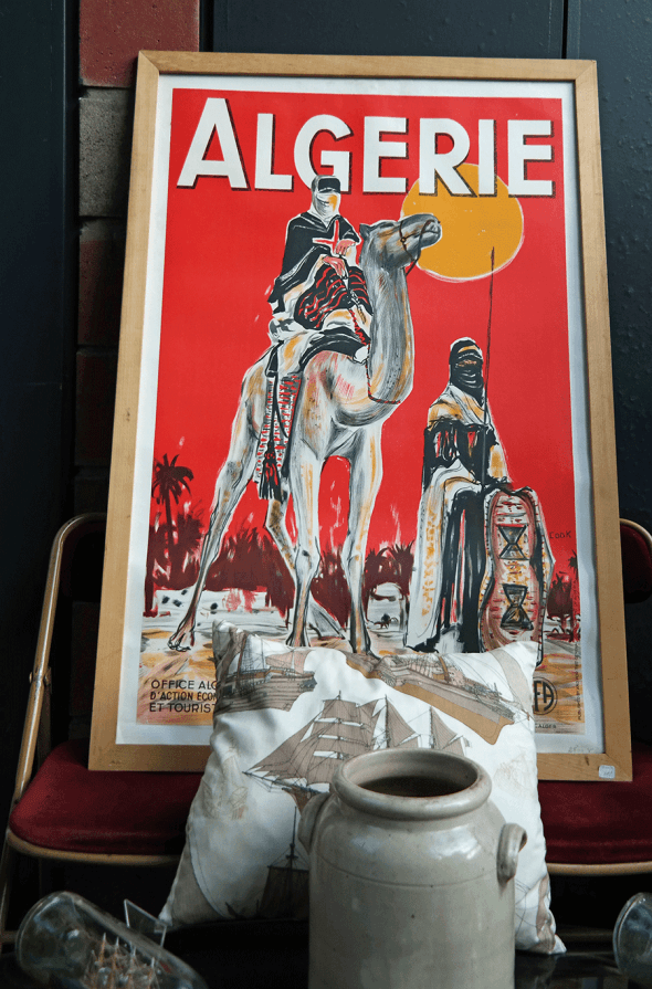 Travel posters are a great way to decorate. Find them from flea markets!