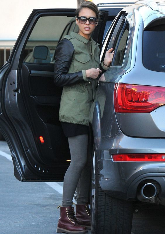 Jessica Alba wearing military jacket and dr martens