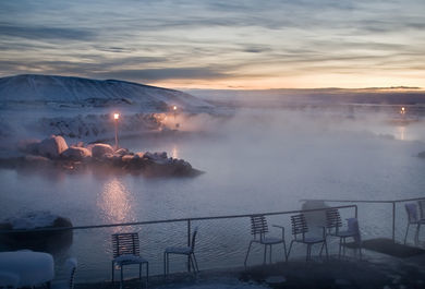 natural pool waters of a geothermal spa, in the lava fields coupled with jaw-dropping views of the grand Lake Myvatn.