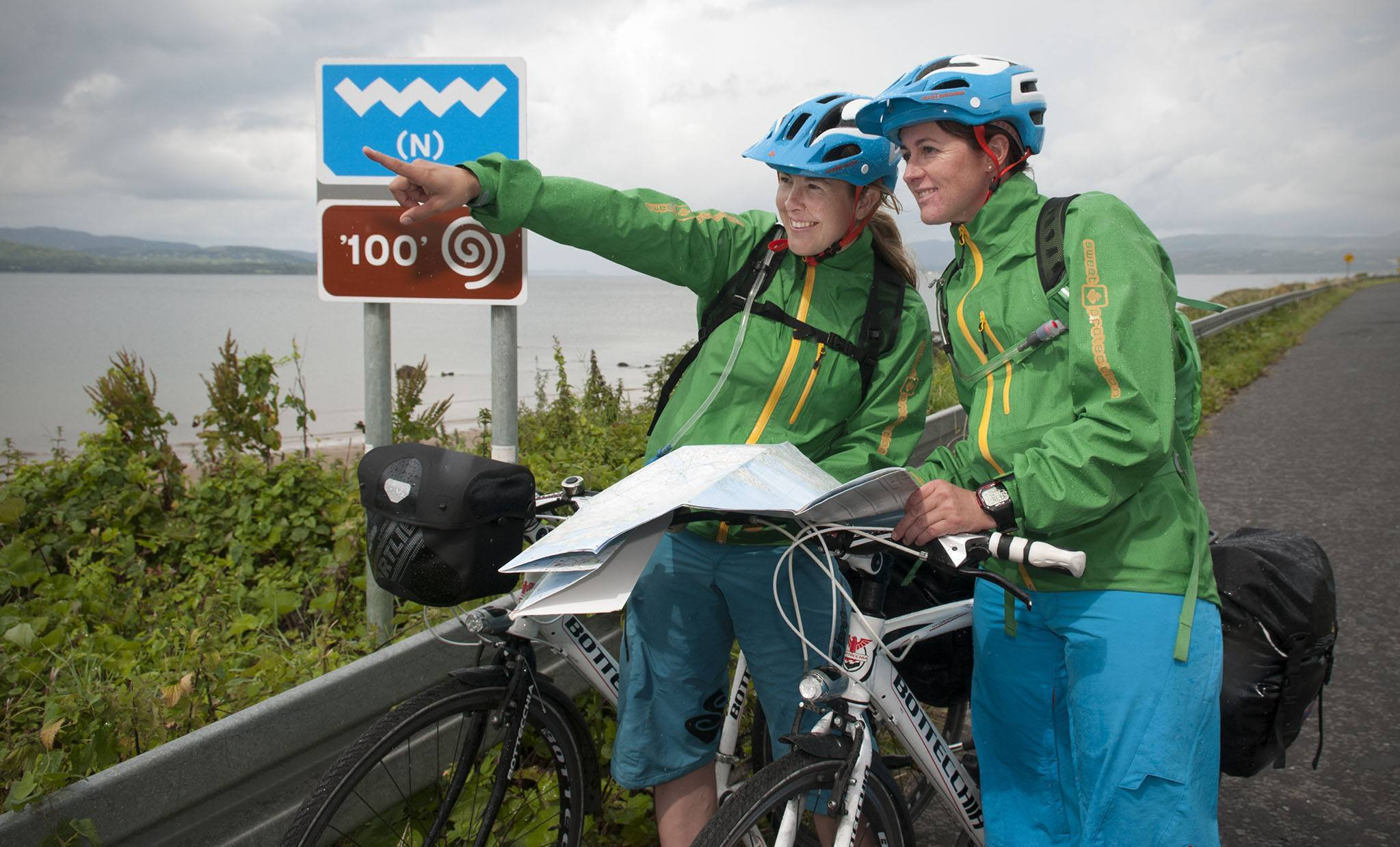 """REPRO FREE 05/08/2014, Buncrana, Co Donegal – Hundreds of thousands of people in Scandinavia, and elsewhere around the world, are set to read all about the Wild Atlantic Way. Finnish travel blogger Satu Vänskä-Westgarth is about to take on the """"challenge of her lifetime"""" – cycling the entire Wild Atlantic Way, or some 2,500 kms along Ireland's western seaboard over the next five weeks. Tourism Ireland invited Satu to undertake the marathon cycle – to experience our newest visitor attraction and then inspire her readers and followers to come and discover it for themselves.  PIC SHOWS: Finnish travel blogger Satu Vänskä-Westgarth (left) and her cycling companion Anne-Marit Storødegård, at Lisfannon Beach, Buncrana, as Satu sets off on her challenge to cycle the entire length of the Wild Atlantic Way. They are here as guests of Tourism Ireland. Pic – Evan Logan (no repro fee) Further press info – Sinéad Grace, Tourism Ireland 087-685 9027"""